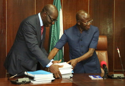 Governor Elect Godwin Obaseki and Governor Adams Oshiomhole,  during the official handing over to Obaseki Friday night at Government House.