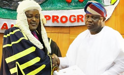 Lagos State Governor, Mr. Akinwunmi Ambode (right), handing over the Y2017 Budget Estimates to the Speaker, Lagos House of Assembly, Rt. Hon. Mudashiru Obasa during the presentation of the Y2017 Budget Estimates to the House, at the Assembly Complex, Alausa, Ikeja, on Tuesday, November 29, 2016