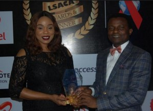 L-R: Dr. Oluseyi Temowo, CEO, Lagos State AIDS Control Agency (LSACA) presenting the award for HIV & AIDS Response in the State to Chioma Okolie, Lead CSR, Airtel Nigeria at the maiden LSACA Awards & Dinner.