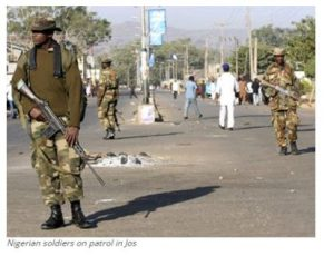 Nigerian soldiers on patrol in Jos