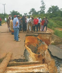 *Delta State Commissioner for Works, Chief James Augoye and others during an on-the-spot assessment of the collapsed culvert on the Jesse-Boburuku road.