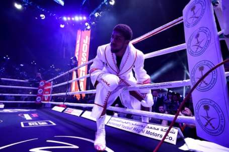 Pictures as Anthony Joshua reclaims titles
