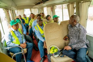 Fashola turns 'Bus conductor' on highways