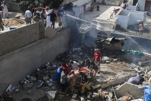 At least two survivors pulled from Pakistani airliner crash wreckage