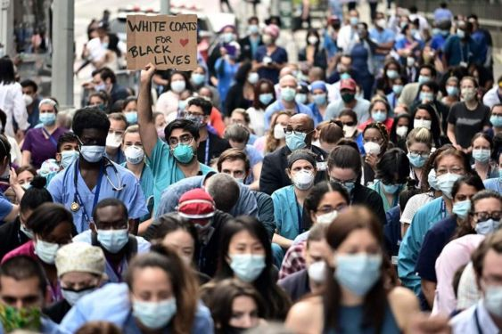 'They are the heroes now': Doctors treating COVID-19 join racism protests