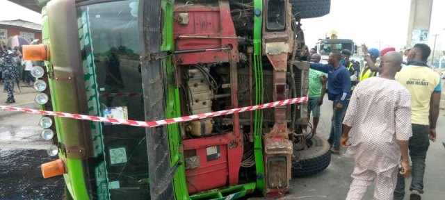 Two dead, as container-laden truck falls on bus in Lagos