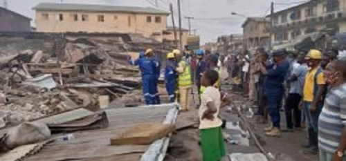 LASEMA demolishes buildings gutted by fire in Lagos