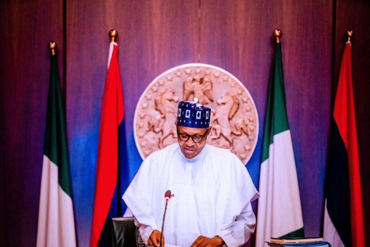 PHOTOS: Buhari presides over FEC meeting, unveils Nigeria at 60 anniversary logo