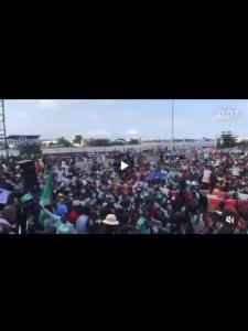 HAPPENING NOW: Protesters hoist flag, sing National Anthem at Lekki Tollgate
