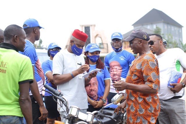 Paul Orajiaka (m) surrounded by his survey team members interviewing an elderly man in Ukpo town,  Dunukofia LGA, on the challenges faced by residents in the area.