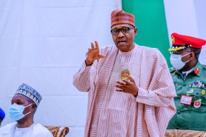 We're struggling with debts— Buhari