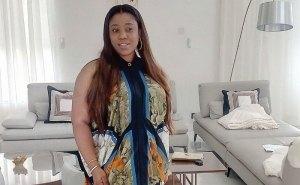 I dress sexy to keep my husband away from girls — Dora, wife of Nigerian striker, Olanrewaju Kayode