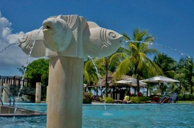 THE CRIMSON RESORT & SPA – MACTAN, CEBU – PHILIPPINES - Fish spraying water in the pool