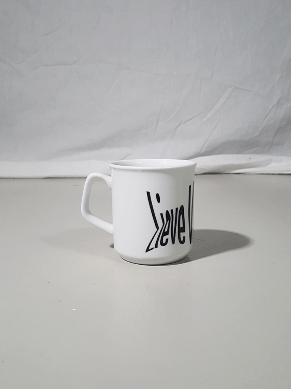 Lieve Van Gorp white coffee mug with distorted logo