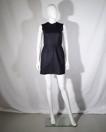 vintage Comme des Garçons black dress with padded hips — fall 1998