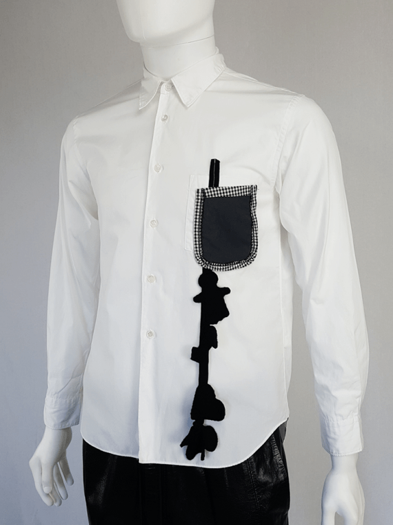 Comme des Garçons Homme Plus white shirt with hanging dolls — spring 2010