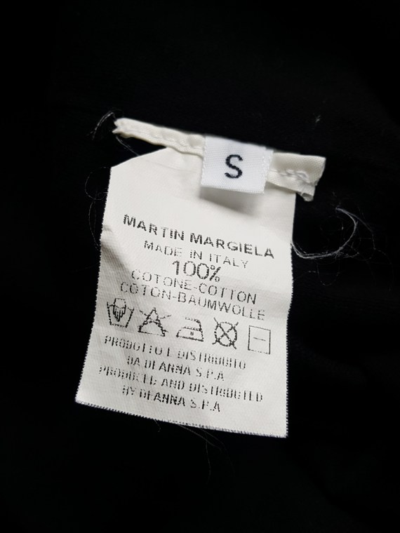Maison Martin Margiela black t-shirt hanging on the front of the body — spring 2003