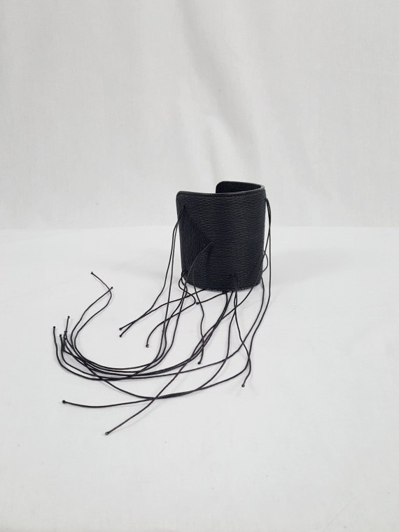 Ann Demeulemeester black leather bracelet with long threads — spring 2012