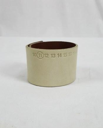 Maison Martin Margiela white leather bracelet with embossed logo — spring 2009