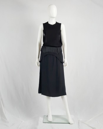 Maison Martin Margiela black dress worn as a skirt — spring 2003