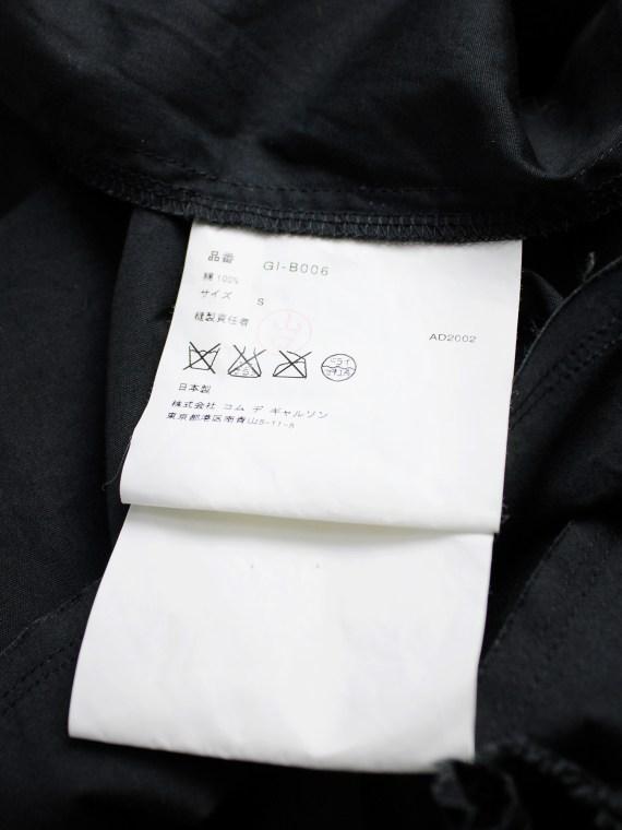 Comme des Garçons black sleeveless top with 3D stars at the hem — AD 2002