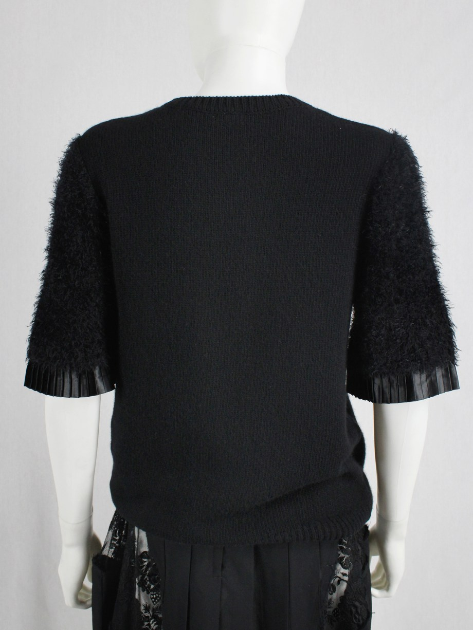 Noir Kei Ninomiya black knit top with fluffy sleeves and pleated trim — fall 2016