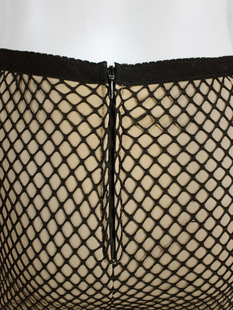 Maison Martin Margiela nude leather trousers with black fishnet overlayer — fall 2011