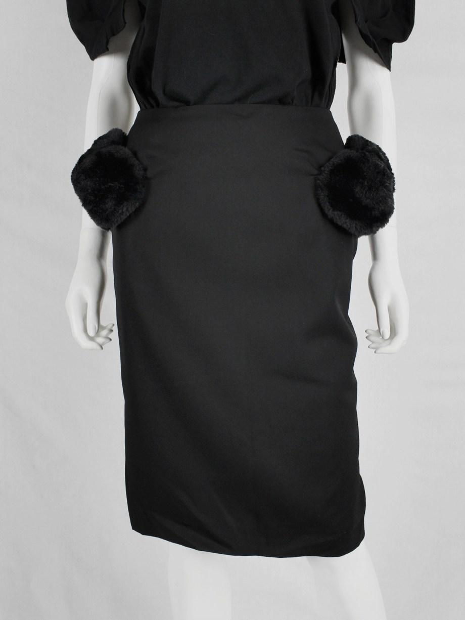 Noir Kei Ninomiya black pencil skirt with furry puffballs on the hips — fall 2016