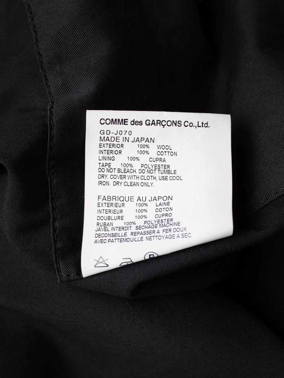 Comme des Garçons dark blue coat with drape and trompe-l'oeil seams — fall 2009