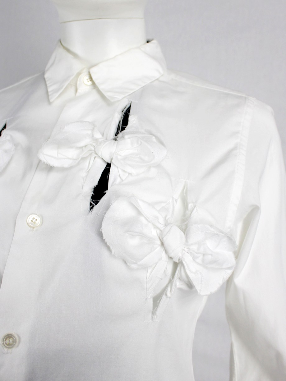 Comme des Garçons white shirt with slits and three bows — spring 2002