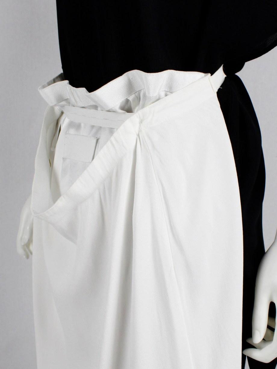 Maison Martin Margiela white skirt worn on the front of the body — spring 2004