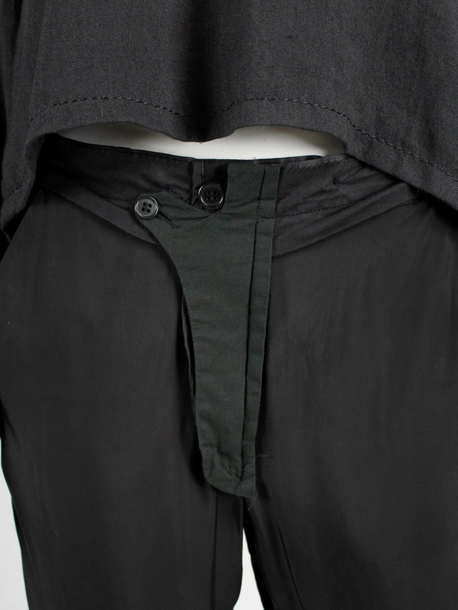 Maison Martin Margiela black trousers worn inside-out — spring 2005