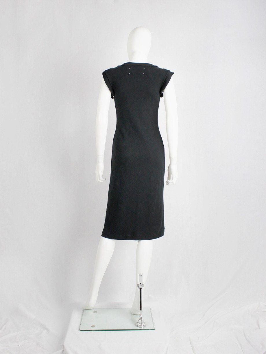 Maison Martin Margiela reproduction of a 1993 black dress with shoulder snap buttons — spring 1999