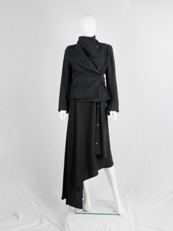Ann Demeulemeester black coat with standing neckline and asymmetric button closure — fall 2010