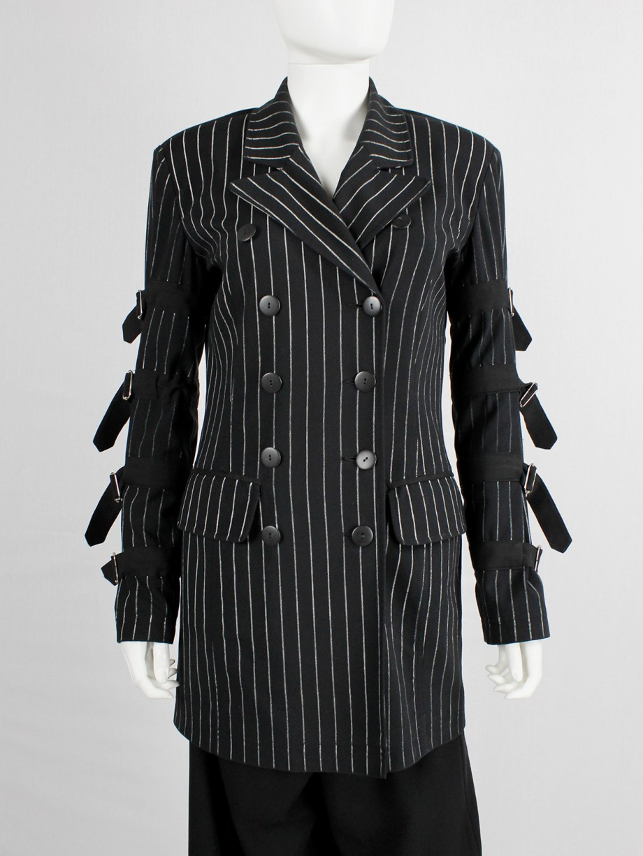 Marithe + Francois Girbaud navy pinstripe blazer with belts around the sleeves