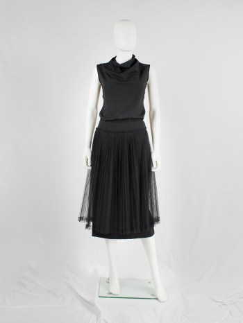 Comme des Garçons black pencil skirt with attached pleated mesh skirt — fall 2004