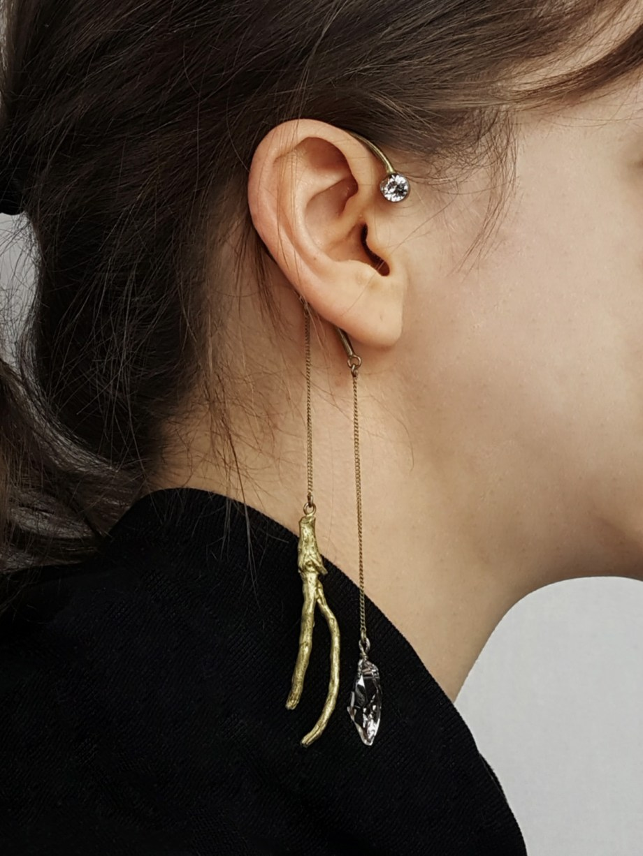 Dries Van Noten gold earcuff with dangling branch and diamond cut glass droplet — spring 2015