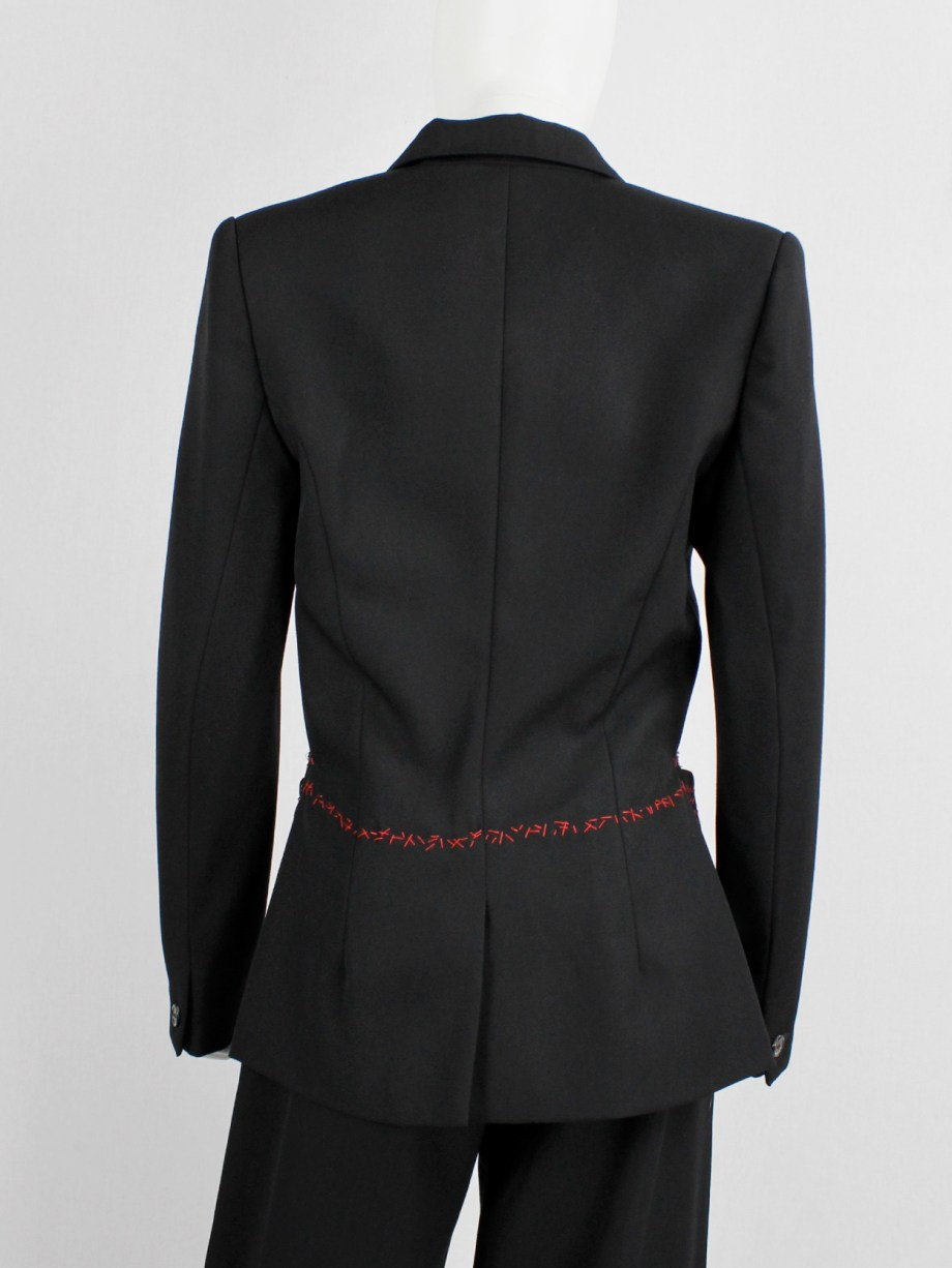 Jurgi Persoons black blazer deconstructed into a tailcoat with red stitches — fall 1999