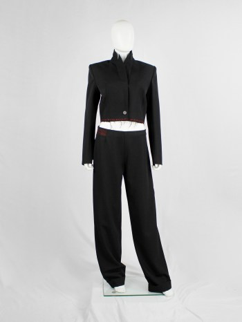 Jurgi Persoons black loose trousers with red stitched waistband and spiral waist — fall 1999