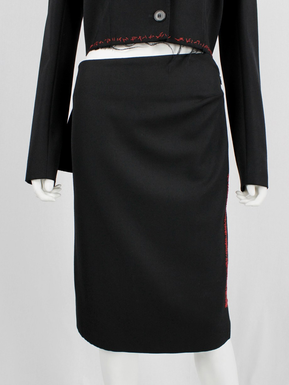 Jurgi Persoons black skirt with red stitched rectangular panel and spiral waist — fall 1999