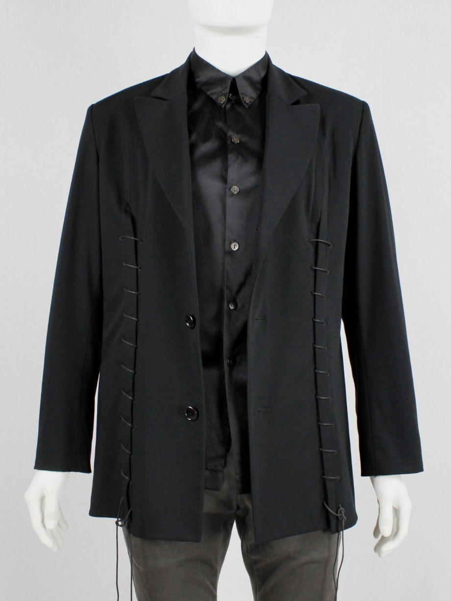 Lieve Van Gorp black tailored blazer with two laced up front slits — spring 2000
