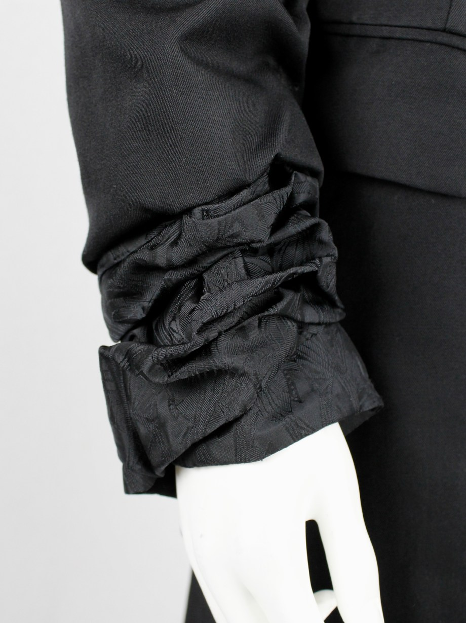 Comme des Garçons black blazer with scrunched lining coming out of the sleeves — AD 1992