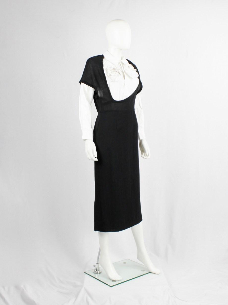 Comme des Garçons black dress with deformed upper and extra low neckline — spring 1999