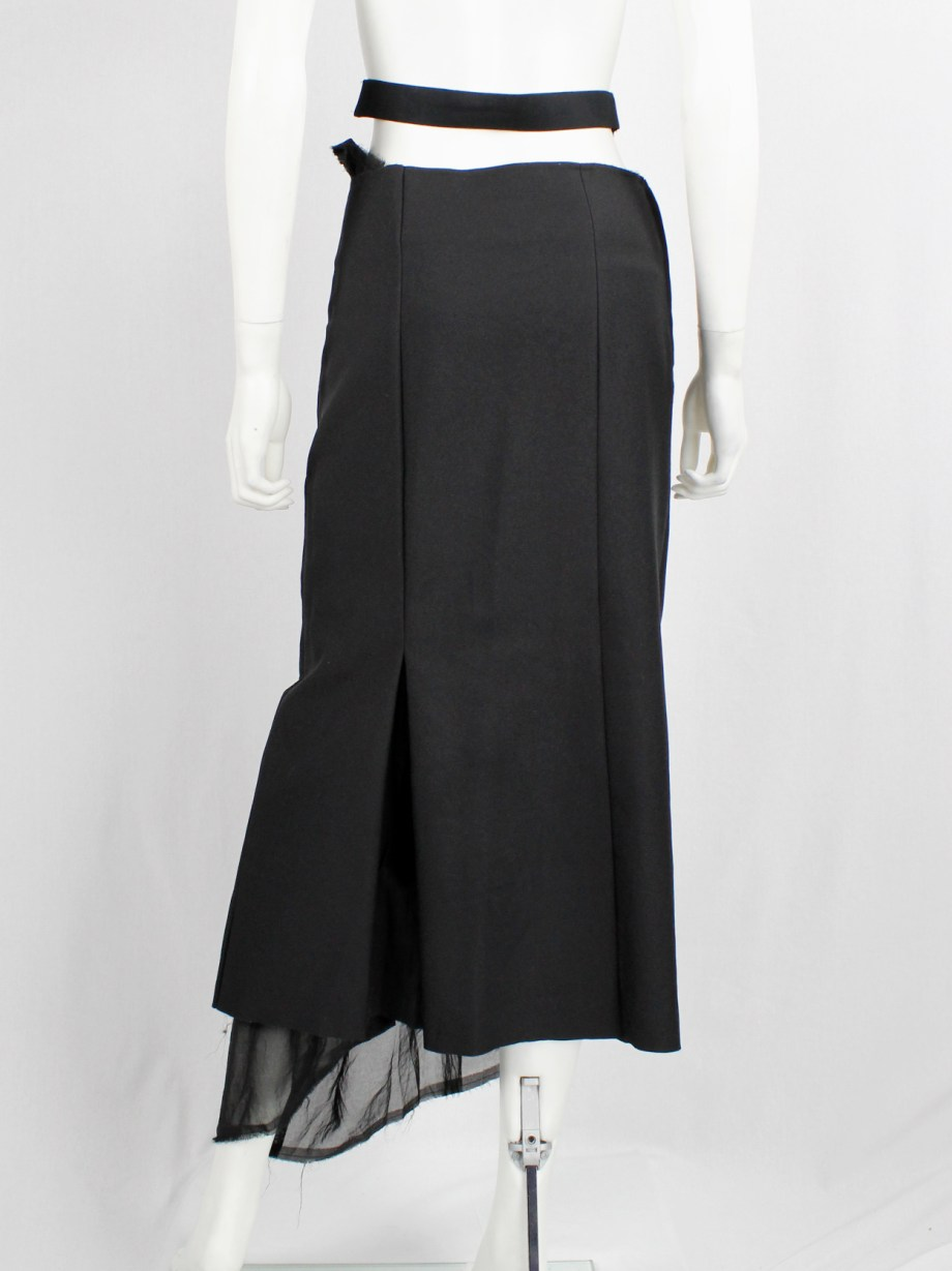 Comme des Garçons black maxi skirt with sheer torn lining coming through the slits — AD 1998