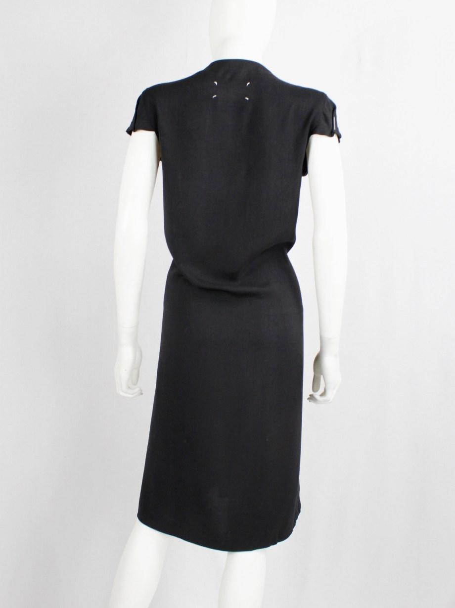 Maison Martin Margiela black midi dress tucked with oversized staples — fall 2007