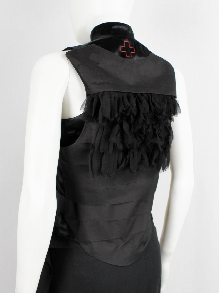 A.F. Vandevorst black panneled back harness with rows of ruffles — fall 2002