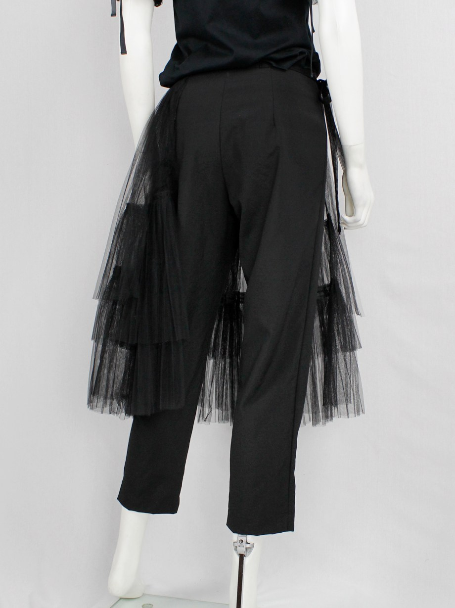 Comme des Garçons black trousers with tiered tulle half-skirt — fall 2004