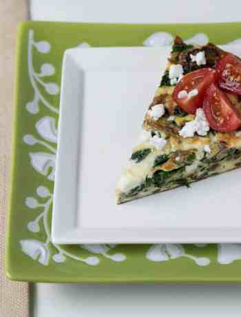 slice of spinach frittata with mushrooms and feta