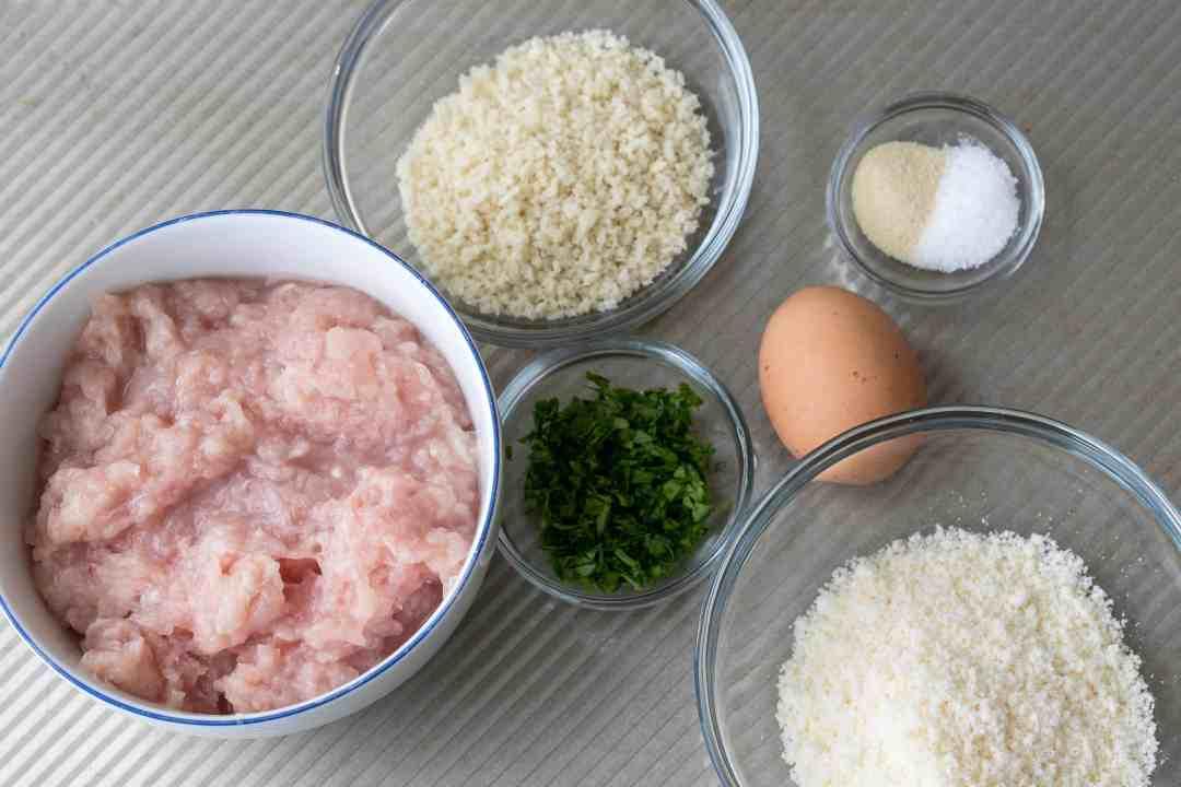 ingredients for chicken parm meatballs: ground chicken, breadcrumbs, egg, parmesan cheese, parsley, garlic powder, salt