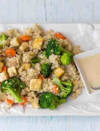 quinoa grain bowl with broccoli, carrots, tofu, and sesame-ginger dressing